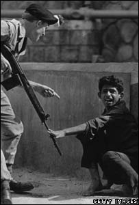 British soldier with terrified civilian in Aden in 1967