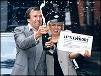 Actress Joanna Lumley helps a pools winner celebrate in the 1990s