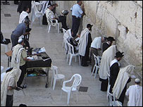 Jews praying at the male section of the Western Wall