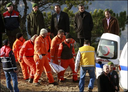 Soldiers and rescue workers carry body at crash site, near Keciborlu, in Isparta province, Turkey..