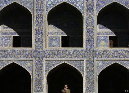 Man prays, Imam Mosque, Isfahan, Iran.