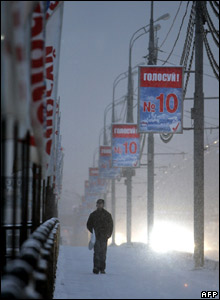 A man walks past signs advertising the pro-Kremlin United Russia party in Moscow.