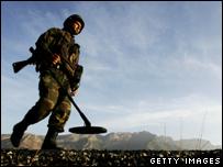 A soldier clears a landmine field in Turkey