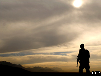 A soldier patrols a landmine field in Kabul, Afghanistan