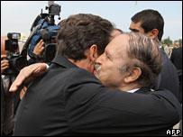 Algerian President Abdelaziz Bouteflika (r) welcomes Nicolas Sarkozy (l) to Algeria in July