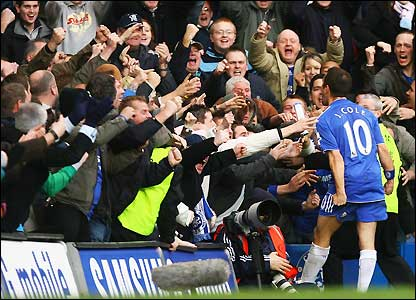 Cole celebrates his winner with the fans