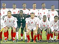Romauld, bottom left, with the rest of the Benin national team