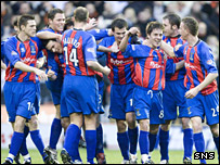 Ian Black is mobbed by his team-mates after giving Inverness the lead