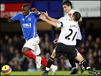 Portsmouth's Sulley Muntari (left) skips away from Everton's Leon Osman and Tim Cahill