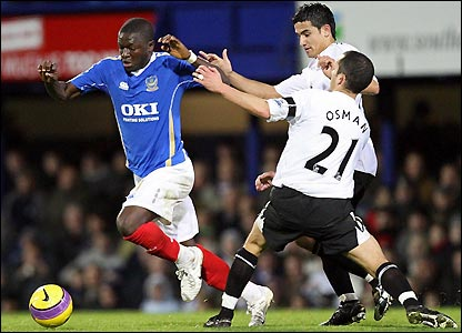 Muntari looks to get past Osman