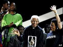 Former South African President Nelson Mandela and his wife Graca Michel arrive at the 46664 World Aids Day Concert in Johannesburg.