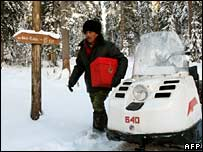 Election officials deliver a ballot box in Shor-Taiga, 4,000km east of Moscow