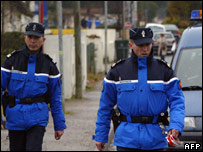 French police work on the scene where suspected members of Eta shot dead a Spanish civil guard