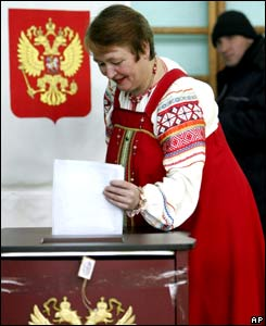 A woman dressed in local folk costume casts a ballot in the town of Krasnyi, 55km west of region capital of Smolensk, western Russia.