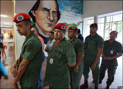 Venezuelan National Guard soldiers line up to vote in the referendum at a polling station in Caracas (02/12)