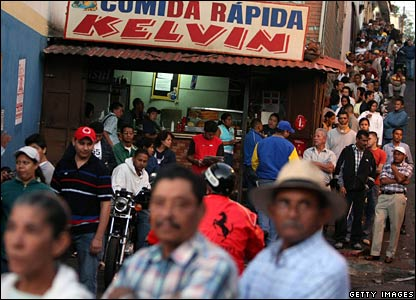 Voters line up at dawn before casting their ballots at a polling station in Petare, Caracas (02/12)