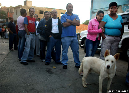 Voters line up to cast their ballots at a polling station in Petare, Caracas (02/12)