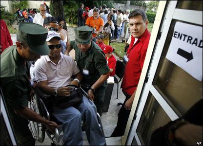 A Venezuelan patient undergoing treatment in Cuba arrives at the Venezuelan embassy in Havana to cast his vote (02/12)