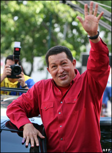 Venezuelan President Hugo Chavez waves to supporters after voting in the constitutional referendum in Caracas (02/12)