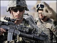 A US soldier prepares for battle against the Taleban in eastern Afghanistan (25 November)