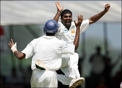 He's done it! Murali jumps for joy as he becomes the world's leading Test-wicket taker, Paul Collingwood his 709th victim