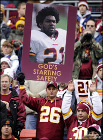 Fans hold up a poster in honour of Sean Taylor