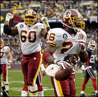 "Clinton Portis raises his jersey to reveal a shirt bearing the words ""In memory of Sean Taylor"" after scoring the only touchdown of the game"