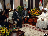 Sudanese President Omar al-Bashir (right) with Lord Ahmed (second left) and Baroness Warsi (left)