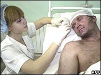 A nurse bandages the head of an injured miner at a hospital in Donetsk on Monday 3 December