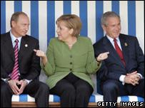 Vladimir Putin (left), Angela Merkel and George Bush