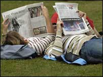 People reading newspapers in the park, BBC