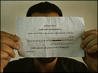 Iraqi refugee in Lebanon holds up a death threat sent to his family (Photo by Zalmai)