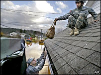 Two members of the Washington state National Guard help evacuate a flooded home in Centralia, on 4 December 2007
