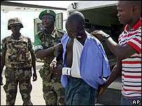 Ugandan peacekeepers in Somalia help an injured comrade, 24 October 2007