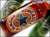 Bottles of Newcastle Brown Ale and Heineken, and can of Carlsberg