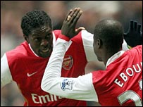 Emmanuel Adebayor (left) celebrates scoring with provider Emmanuel Eboue