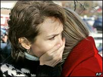 Shocked people outside the Westroads Mall in Omaha, US state of Nebraska, after a shooting on Wednesday