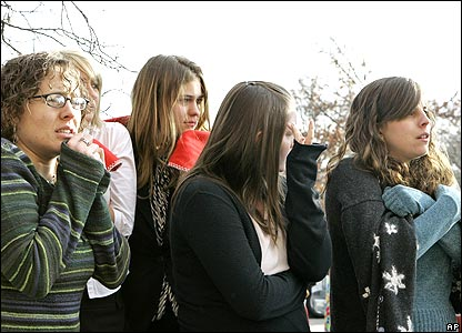 Girls waiting outside mall
