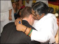 Amma giving a hug