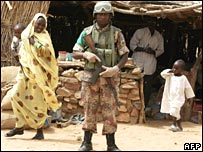 African Union soldier patrols a village in Darfur