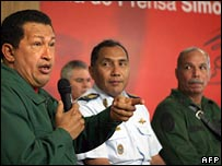 President Chavez (left) addresses a news conference with high-ranking military chiefs