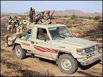 Chadian soldiers patrol the battlefield