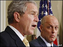 President Bush (left) and Treasury Secretary Henry Paulson