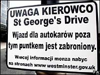A road sign in central London, translated into Polish