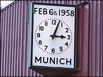 A clock at Old Trafford shows the time of the air crash on 6 February 1958