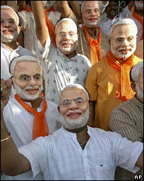 Mr Modi's supporters wearing masks of the chief minister at an election rally