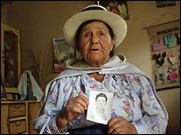 Angelica Mendoza holding photo of her son, Arquimedes Ascarza Mendoza