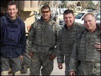 BBC's Mark Urban (L) stands next to Specialist Benjamin Jones (C) and members of 2nd Platoon