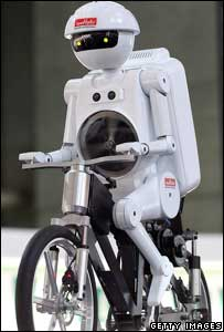 Robot riding bicycle, Getty
