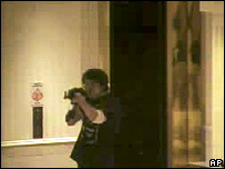 CCTV footage showing Robert Hawkins aiming his gun